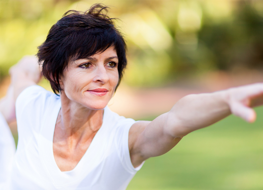 women practicing yoga as treatment for menopause