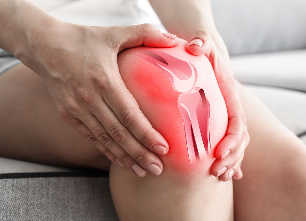 person gripping inflamed knee