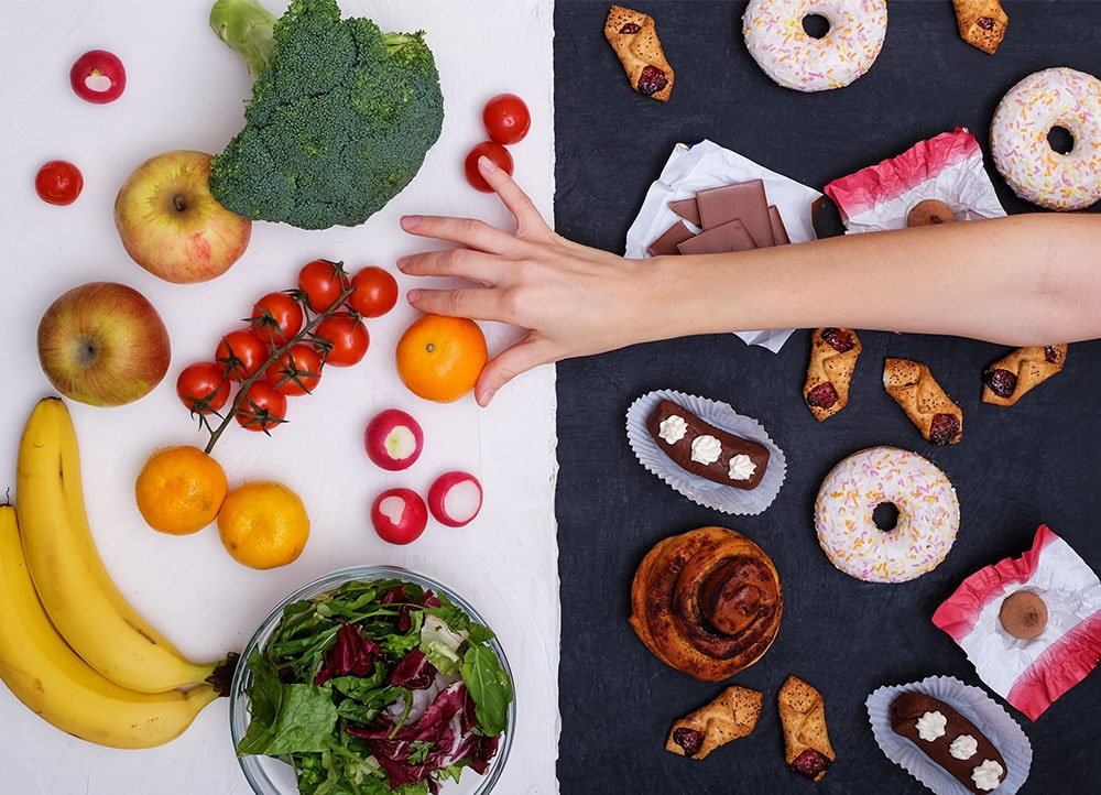 hand reaching for healthy alternative to stress eating junk food