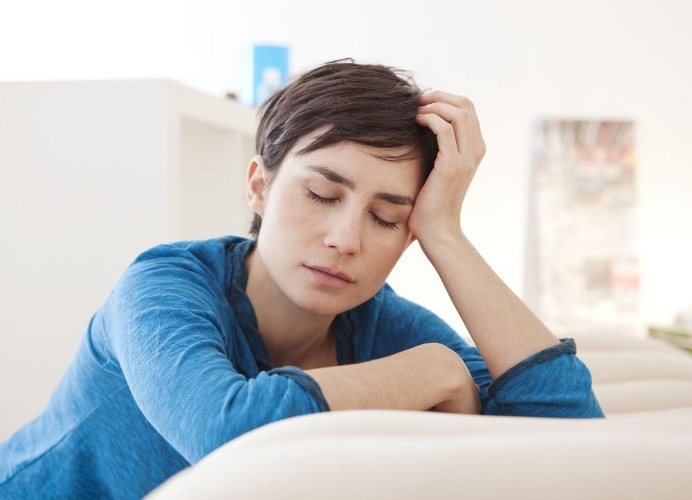 fatigued woman suffering from an iron deficiency