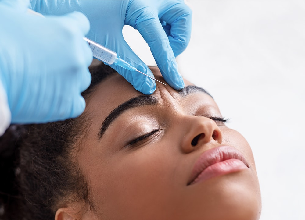 woman receiving botox treatment between eyebrows in indianapolis, in