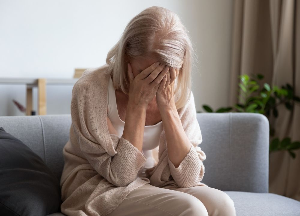older woman suffers through the symptoms of hormone imbalance