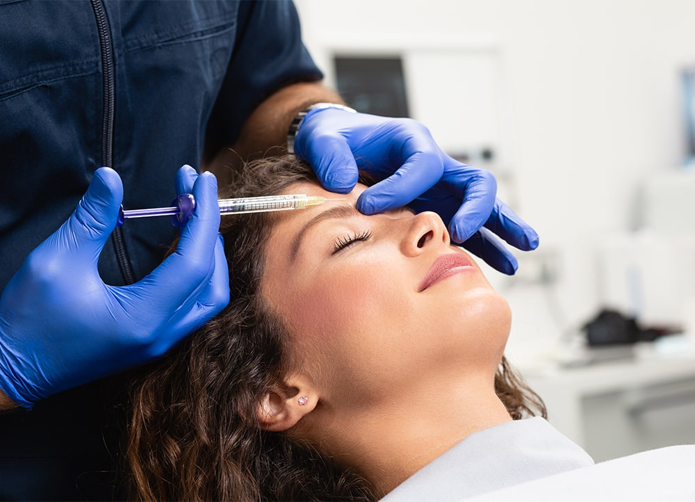 woman receiving forehead Botox at the doctor's office